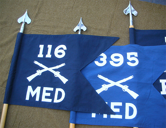 Left: Guidon, Medical Detachment, 116th Infantry Regiment, 29th Infantry Division (Campaign credits; Normandy, Northern France, Rhineland, Central Europe). Right: Guidon, Medical Detachment, 395th Infantry Regiment, 99th Infantry Division (Campaign credits: Rhineland, Ardennes-Alsace, Central Europe).