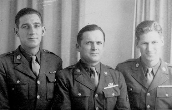 Private First Class Roger K. Powell (L), ASN 35425054, and 2 unidentified members of the 326th Airborne Medical Company. Photo taken at the end of the war. (Pfc R. Powell was killed in Normandy 8 June 1944, and is buried in the Normandy American Cemetery). Photo courtesy Cindy Ball.