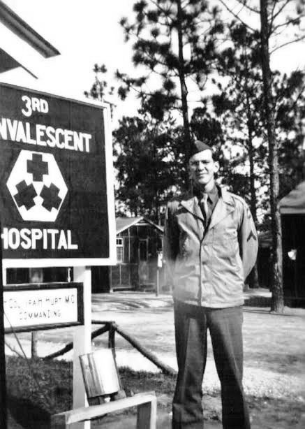 Picture of Private First Class Ralph K. Sellers at Camp Livingston, Alexandria, Louisiana (AGF Training Station and Reception Center where the 3d Convalescent Hospital was stationed, please see signpost). Pfc Sellers entered into active service at Camp Perry, Ohio, 22 September 1942, from where he was most probably transferred to Camp Livingston as a member of the cadre which helped form and increase the newly-activated 4th Convalescent Hospital. Picture taken in 1943.