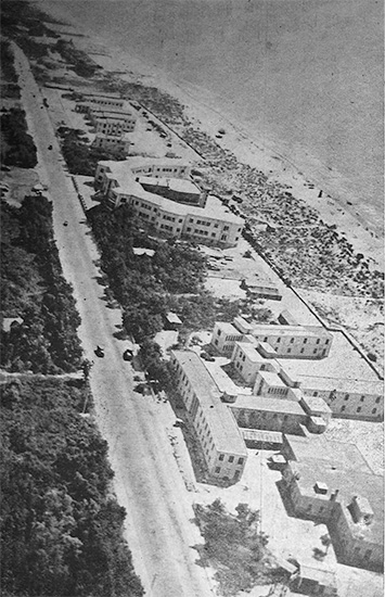 Aerial view taken from a Piper Cub showing the buildings comprising the 33d General Hospital at Livorno (Leghorn), Italy. West of the location was a beach and east of the site a dense wood. Photo taken during the unit's stay, October 1944 - September 1945.