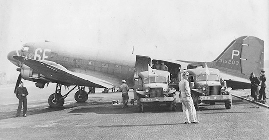 Two WC-54 ambulances deliver their load of patients in need of additional hospitalization for air evacuation to the Zone of Interior. At the time (December 1944) the 74th General Hospital was operating as a Holding Hospital preparing patients for transfer to the United States (of particular interest are the vehicles' markings, with CZ designating Communications Zone).Courtesy Gregory Sobieski.