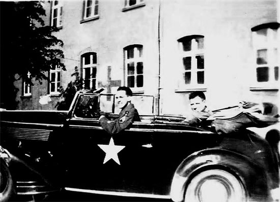 Staff Sergeant Ralph K. Sellers driving a German 'booty' car while stationed in Arolsen, Germany. Picture taken 4 June 1945.