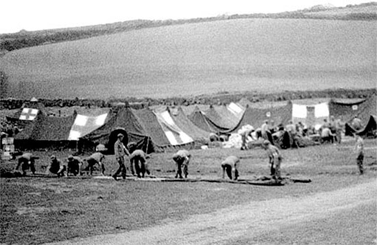 Cornwall, England. Personnel of the 261st Amphibious Medical Battalion are installing their tents in the field.
