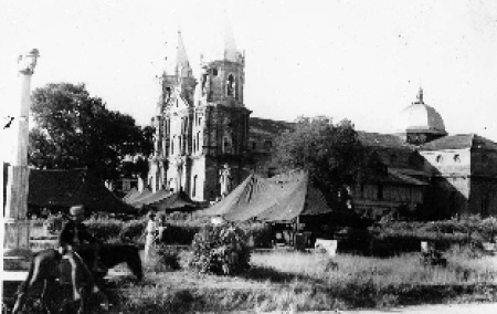 Ward tents of the 99th Evacuation Hospital in the plaza at Molo, Panay, Philippine Islands sometime between August and September 1945. (First Sergeant Elmer R. Young Collection).