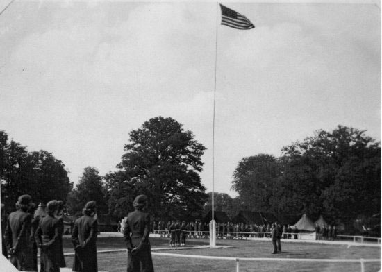 Illustration showing a flag raising ceremony at the unit during its time at the Shortgrove Estate.