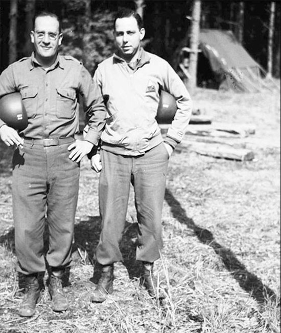 "Photo illustrating Captain Isadore ""Doc Shechner, MC (left) together with an unidentified Officer of the 70th Tank Battalion (copyright Roberts Armory, via Michael A. Krizsanitz)."