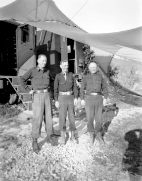 "Photo illustrating from L to R: Brigadier General Robinson E. Duff (Asst. DivIsion CG), Major General George P. Hays (Division CG), Brigadier David L. Ruffner (Division Artillery CG), all General Officers of the 10th Mountain Division, operating in Italy. BG Robinson E. Duff was a patient at the 33d General Hospital in May 1945 and had nothing but praise for the 33d. He left a special note on V-mail to the editor of ""The Corpsman"" commending the organization."