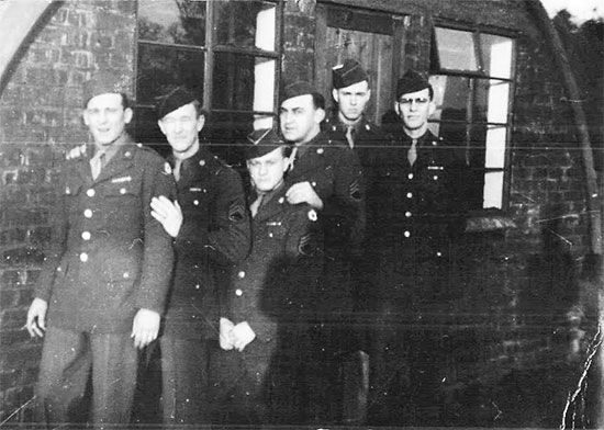 Picture illustrating some Enlisted Men of the 4th Convalescent Hospital, standing in front of a Nissen hut (location unknown). It appears to have been taken later during the war, as the men's uniform coats are adorned with medal ribbons ... the building seems reminiscent of the ones constructed in the United Kingdom ... From L to R: Nick DeBerdanint, Grady White, Bill Pointer, Herb Singertot, Murl Skaggs, and Ralph K. Sellers.