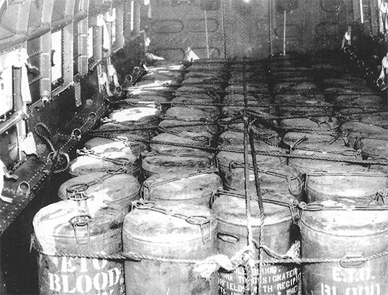 """ETO Blood Bank"" Containers on their way to the Continent. Picture taken on board a C-47 cargo plane, following D-Day Operations."