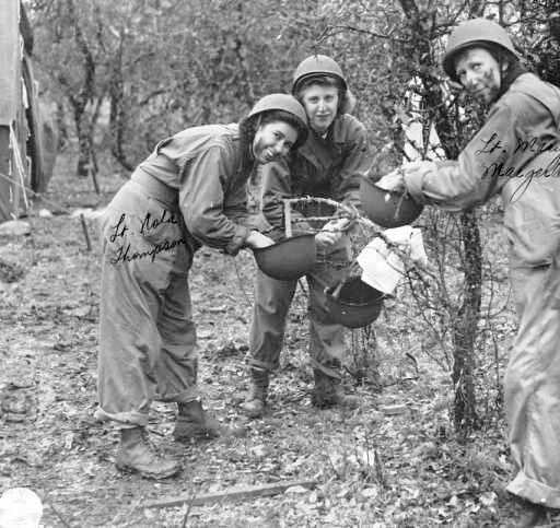 Nurses of the 12th Field Hospital during training at Camp Bowie, Texas. From L to R: 2d Lieutenant Nola A. Thompson; 2d Lieutenant Sevilla N. Durkop; and 2d Lieutenant Mary J. Maegerlein. Photo taken 15 March 1943.