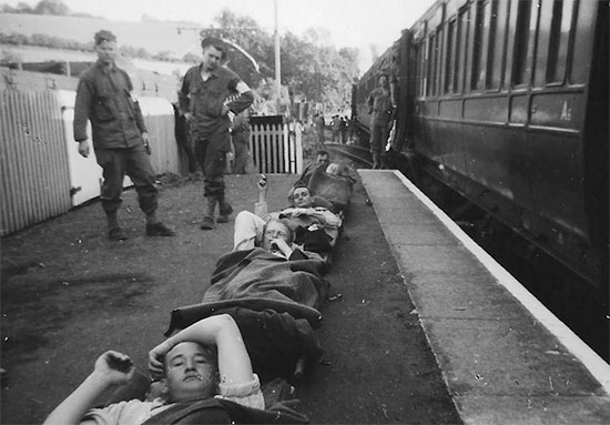 Photograph illustrating 11th Hospital Train personnel with patients in Templecomb, England, July 1944. Courtesy Van P. Keele.