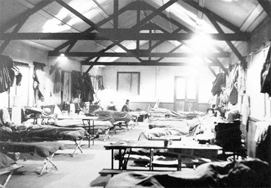 Camp C-5, internal view of Officers' barracks, Westminster, England, before crossing over to France, 23 March 1945.