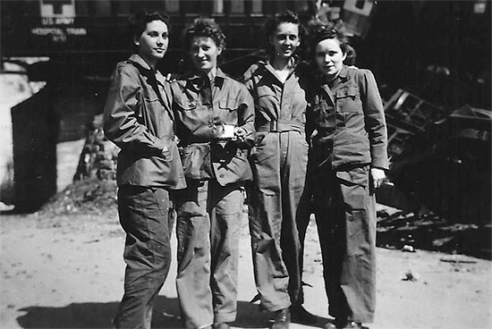 Four Nurses of the 11th Hospital Train pictured in front of train wreckage following the derailment in April, 1945. From L to R: ANC Officers Van Houten, Kenny (Head Nurse), Kennedy, Graham. Courtesy Van P. Keele.