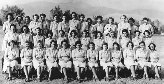 Group photograph showing Nurses of the 11th Evacuation Hospital during training in the ZI. Front row, left to right: Loretta Harris, Cathleen Ligas, Mildred Wells, Margaret Mailloux, Charlotte Johnston, Eleanore Gasline, Charlotte Collier, Waunita Schepper, Muriel Scheckter, Marguerite Hardacre, Doris Watson, Annie Deeds. Middle row, left to right: Helene Gorman, Henrietta Pfeffer, Mildred Taylor, Ernesta Reiff, Dorothy Good, Elizabeth Cook, Louise McElroy, Frances Gilboy, Diana Crosson, Anne Madan, Nellie Musser, Lucille Brown. Back row, left to right: Emelyn Harlow, Virginia Billings, Frances Backer, Catherine Crossan, Eleanor Richey, Bernice Rannells, Lois Pierce, Marjory Frosh, Ida Winchester, Mirian Dunning, Olive Field, Barbara Fraunholz, Ilene LeFevers, Myrtle Costello, Dorothy Woebbeking.