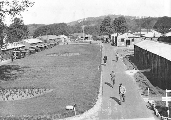 Summer 1944, 74th General Hospital installations at Tyntesfield, Somerset, England. View of main thoroughfare and partial view of the Motorpool at left (see parked vehicles). Courtesy Gregory Sobieski.