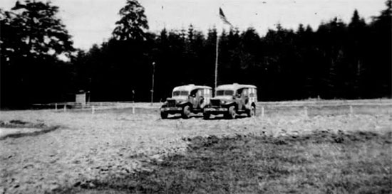 Picture illustrating two 3/4-ton WC-54 ambulances at the parking lot of the 4th Convalescent Hospital's medical facility locateted at Neercanne, near Maastricht, Holland. Picture taken in October of 1944.