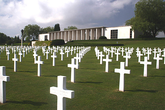 View showing headstones and memorial at the Henri-Chapelle American Cemetery.