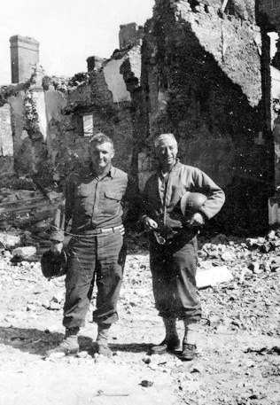 48th Field Hospital personnel. Sergeant Ralph L. Quesinberry (L) and Captain John C. Petrone (R), CO, First Platoon, in Saint-Lô, France.