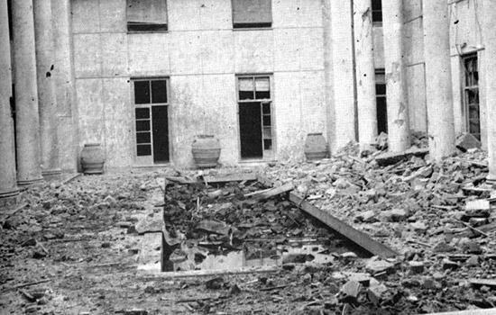 Photograph showing the Building A courtyard. The destruction and devastation caused by the bombing can be seen clearly.