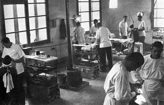 Dentists of the 45th General Hospital hard at work in the Dental Clinic, Naples, Italy. Photograph taken in 1945.