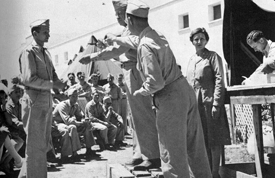 European-African-Middle Eastern Campaign Medals are awarded to members of the 45th General Hospital by Commanding Officer Col. Pfeffer.