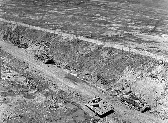 Partial view of the main road leading from Anzio to Rome. Several wrecks of wrecked Allied armor are visible.