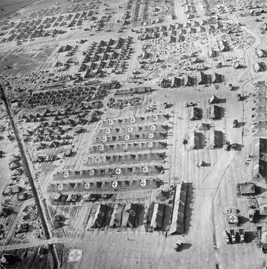 Aerial view of Anzio beachhead, illustrating the American hospital sector. All installations are packed together and clearly identified by numerous GC symbols.