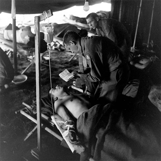 Anzio Beachhead. Fifth United States Army Chaplain comforting or giving last rites to a patient in one of the US hospitals established on the beachhead.