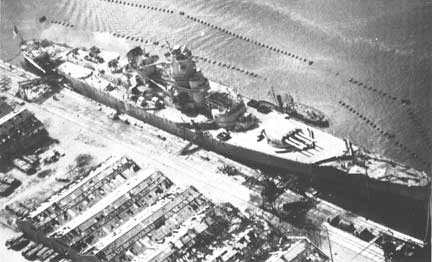 "Aerial view of the docked French Battleship ""Jean Bart"", later severely damaged by Allied air and naval forces 8 November 1942, during Operation ""Torch"", the landing in North Africa."