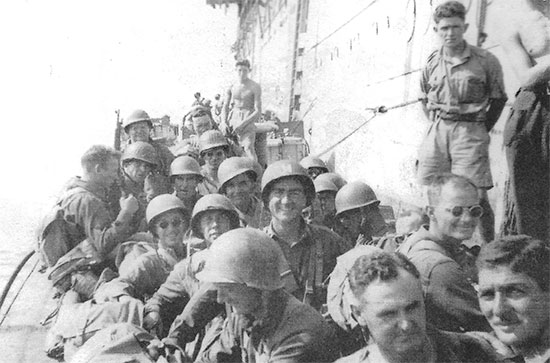"95th Evacuation Hospital personnel having been transferred onto a landing craft are ready and on their way to the landing beach. The picture was taken during Operation ""Avalanche"", 9 September 1943, the Allied landing at Salerno, Italy."