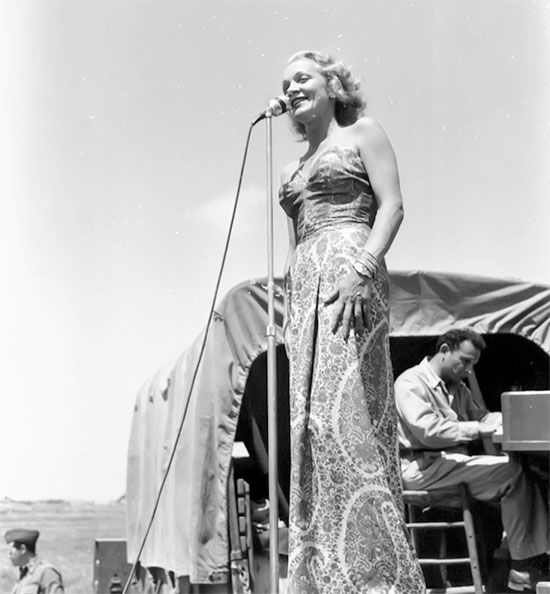 Picture of singer Marlene Dietrich (USO) while visiting the 95th Evac during its stay in Italy.