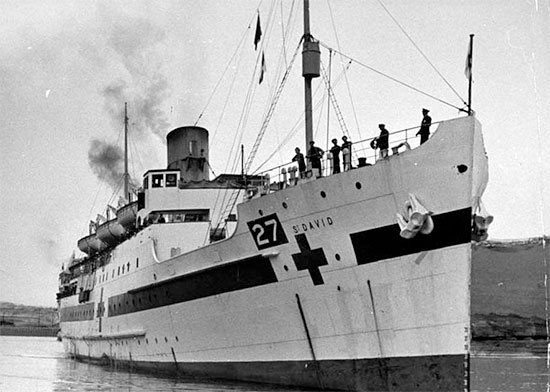 "Picture illustrating the British Hospital Ship ""St. David"". John Daly, CBS correspondent, reported that the Germans deliberately bombed 3 British Hospital Ships off Anzio Bay on 24 January 1944. Although fully lighted up as required by the Geneva Convention, HMHS ""St. Andrew"", HMHS ""Leinster"", and HMHS ""St. David"" were bombed and strafed. HMHS ""St. David"" was sunk as a result of the attack while HMHS ""Leinster was set on fire."