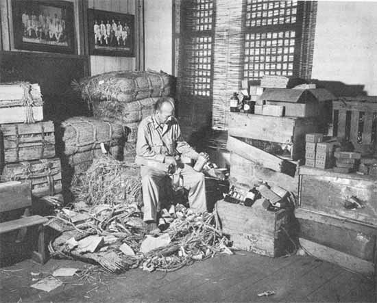 Due to supply issues, Japanese medical items captured on Leyte were distributed across units stationed in Japan. Here, an Officer examines the newly received items at an Evacuation Hospital.