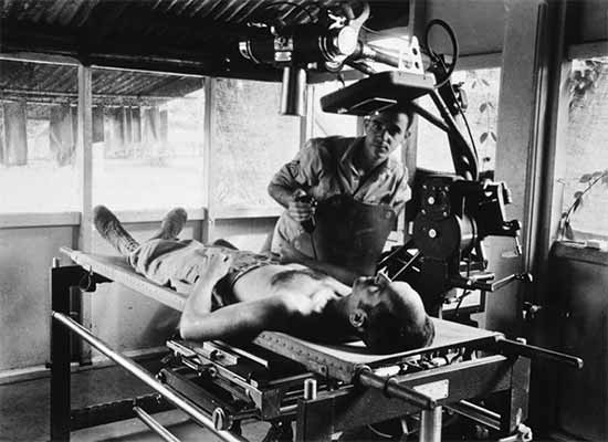 Photograph showing x-ray procedure at the 1st Field Hospital, Milne Bay, New Guinea