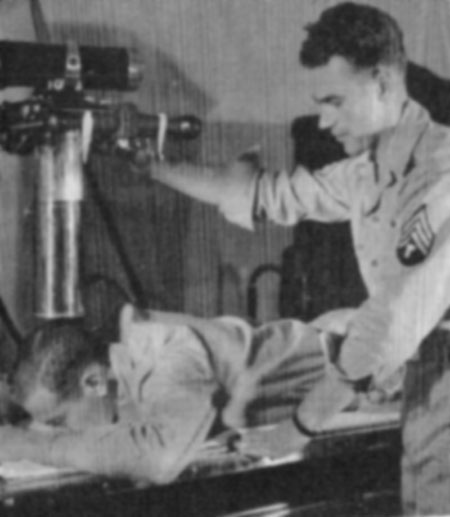An unidentified technician prepares an x-ray at the 26th Gen Hosp.