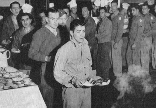 Enlisted Men enjoy a hot meal at the 26th's facility in Bari, Italy.