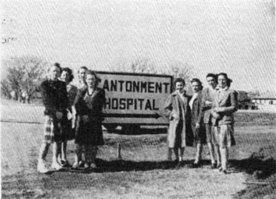 Several members of the 26th's female staff pose in front of the Fort Sill Cantonment Hospital.
