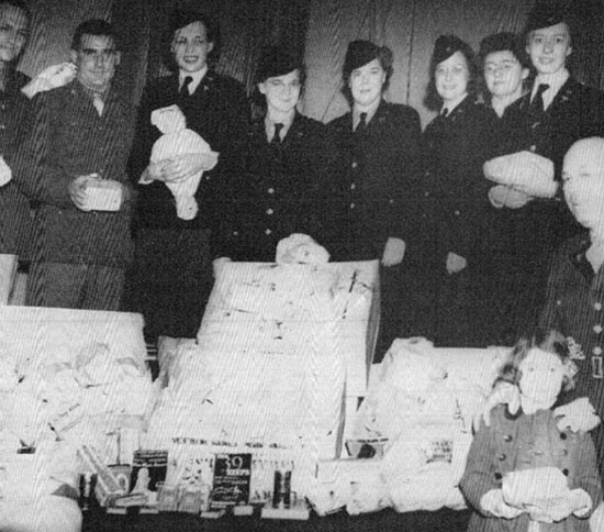 Hospital staff pose proudly for a photograph with gifts and other goodies received from friends and family during their first Christmas overseas.