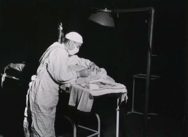 Picture illustrating Surgeon at work in the Operating Room.