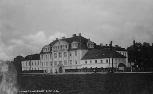 Exterior view of the Landesfrauenklinik, a former civilian hospital in Linz, Austria which housed the 117th Evacuation Hospital during its final months of overseas operations.