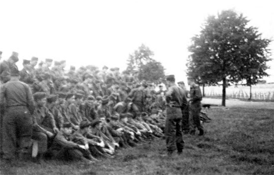 Captain Robert M. Ferrell, Commanding Officer, 603d QM GR Co, holds a briefing in preparation for the Memorial Day celebration to be held at Henri-Chapelle Cemetery, Belgium.