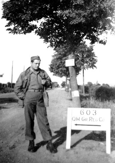 Main road passing near the Henri-Chapelle Cemetery and the 603d QM GR Co Headquarters, leading toward the German border.