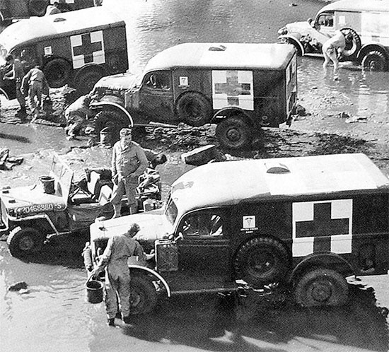 Summer of 1944, France. Personnel of an Ambulance Company take some time to wash and clean their vehicles.