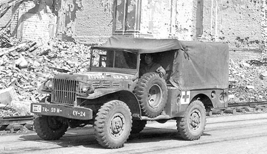 European Theater early 1945. A 3/4-ton weapons carrier (WC-52 type) converted for use, either as an ambulance for evacuating casualties, or just for hauling medical supplies, or transporting personnel (this particular vehicle belongs to the 59th Evacuation Hospital).