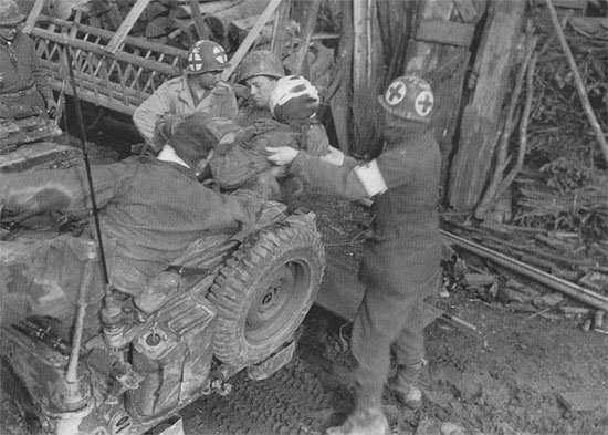 Another vintage photograph illustrating the use of the 1/4-ton truck for evacuation of casualties.