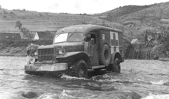 Somewhere in Germany. A 3/4-ton ambulance (WC-54) fords a shallow river (this particular ambulance pertains to the 593d Ambulance Company, Motor).