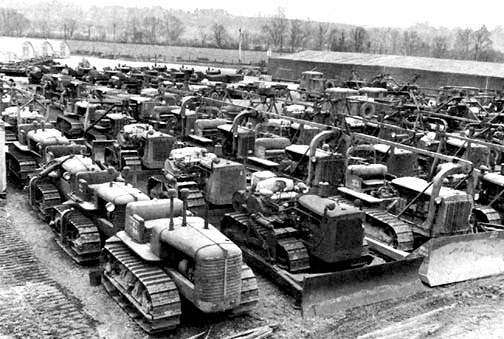 US Forces build-up in the United Kingdom. Outside depot in the country illustrating miscellaneous types of bulldozers.