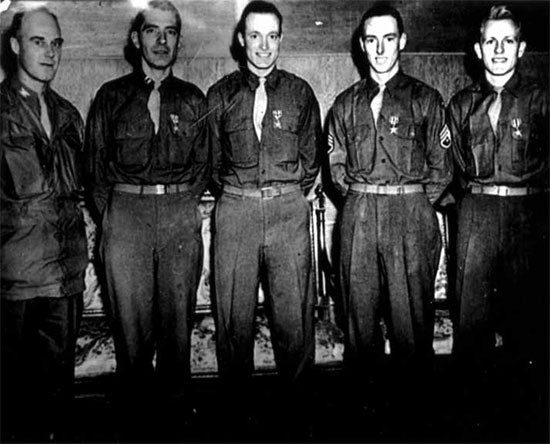 Photo of the 4 members of the 12th Evacuation Hospital showing the men after being awarded the Silver Star. From L to R: Colonel Marshall S. Brown, Jr., CO 12th Evacuation Hospital; Captain Edward N. Zinschlag (General Surgeon), Captain Henry M. Hills (Orthopedic Surgeon), Technician 3d Grade John H. Donohue (Surgical Technician) and Technician 4th Grade Lawrence T. Rethwisch (Surgical Technician).
