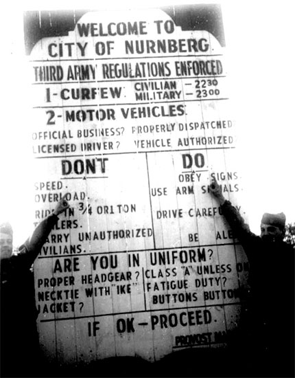 Germany 1945. Signpost detailing regulations enforced by Third United States Army (TUSA) authorities in the City of Nürnberg, Germany.
