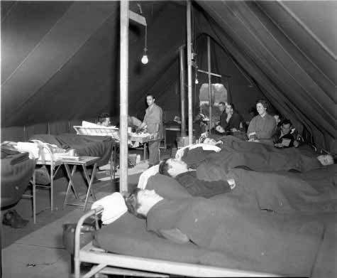 Patients at the 12th Evacuation Hospital, Carmarthen, Wales, United Kingdom, where the organization operated from October 1943 until March 1944.